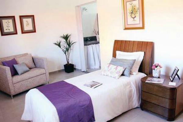 Uma das suites do condomínio, que tem habitações de vários preços